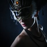 Beauty model wearing venetian masquerade carnival mask