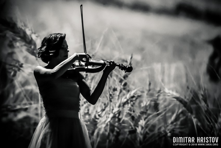 Famous Female Playing Violin photography stage black and white  Photo