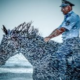 Policeman Riding Horse in The Storm