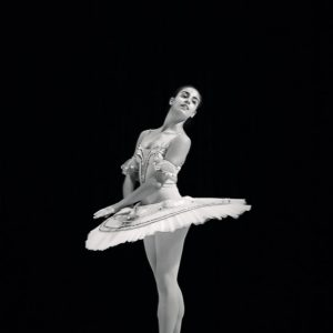 Young ballerina dancer in tutu performing
