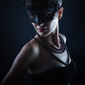 Woman wearing venetian masquerade carnival mask
