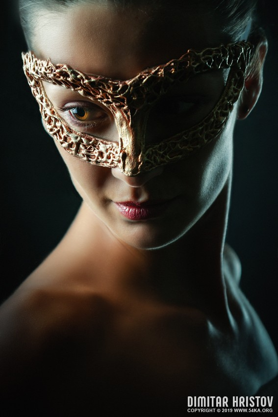 Beauty model woman wearing masquerade carnival mask photography portraits featured fashion  Photo