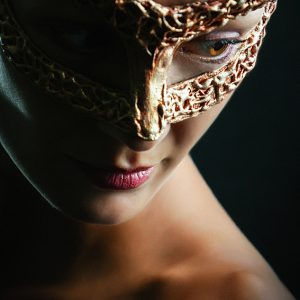 Beauty glamour woman wearing in venetian masquerade carnival mask.