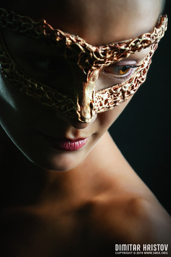 Beauty glamour woman wearing in venetian masquerade carnival mask. photography venetian eye mask portraits featured fashion  Photo