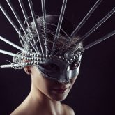 Beauty portrait of young gorgeous girl with silver carnival mask
