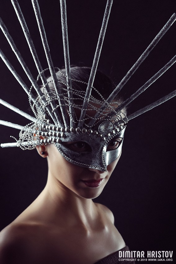 Beauty portrait of young gorgeous girl with silver carnival mask photography venetian eye mask featured fashion  Photo