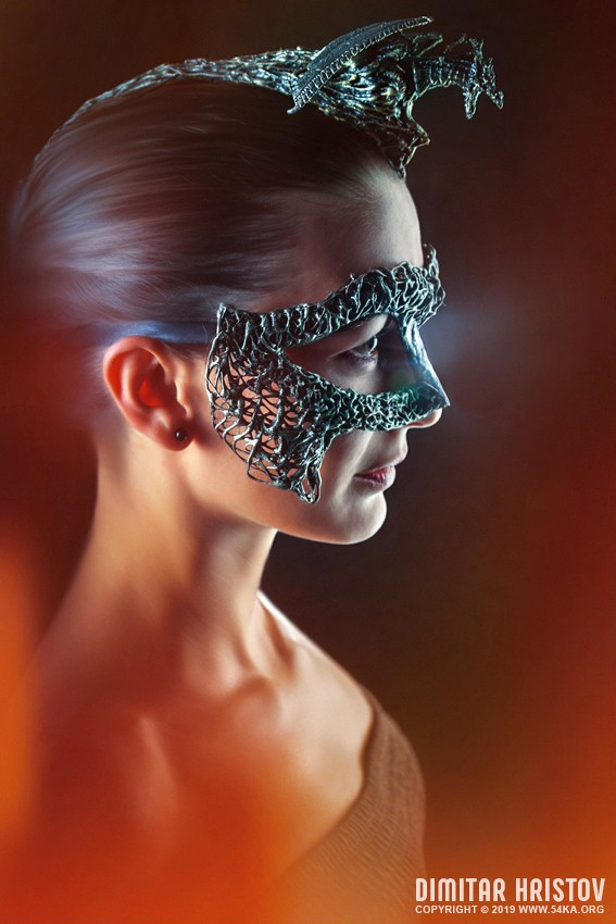 Mysterious woman with crown and dragon mask photography venetian eye mask featured fashion  Photo