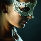 Portrait of young beautiful stylish woman in white lace mask