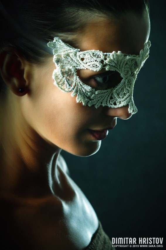 Portrait of young beautiful stylish woman in white lacy mask photography venetian eye mask portraits featured fashion  Photo