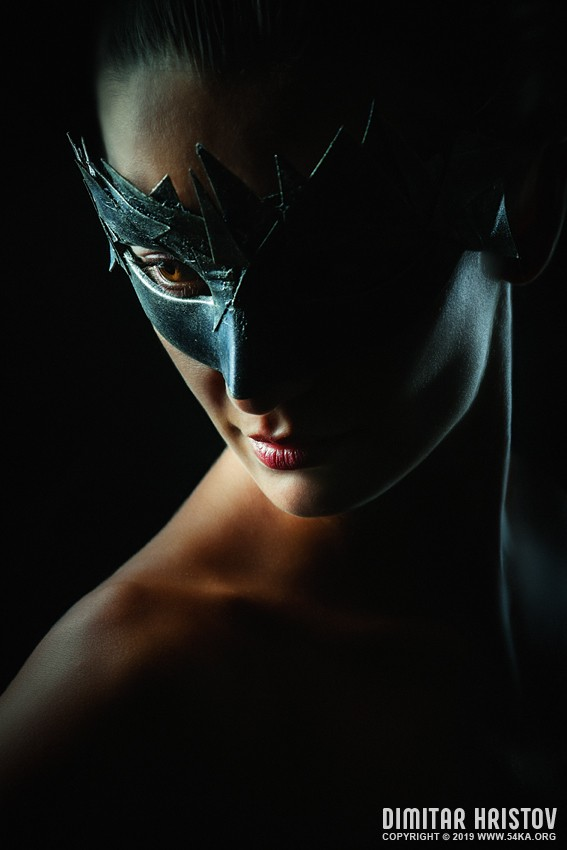 Woman with mask   Strobist portrait in the dark on black background photography venetian eye mask portraits featured fashion  Photo