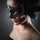 Girl with a black raven feather mask