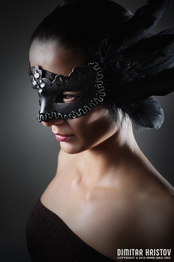 Girl with a black raven feather mask photography venetian eye mask featured fashion  Photo
