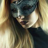 Girl with fashion masquerade ball party eye mask
