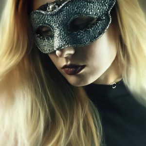 Girl with fashion masquerade ball party eye mask