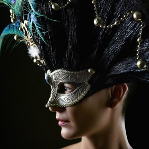 Girl with masquerade mask princess peacock feathers party mask