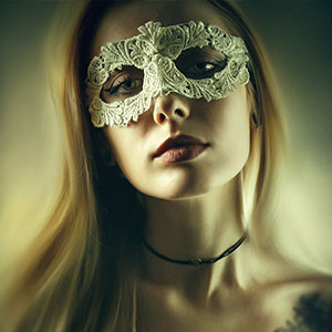 Glamour woman with venetian masquerade carnival mask