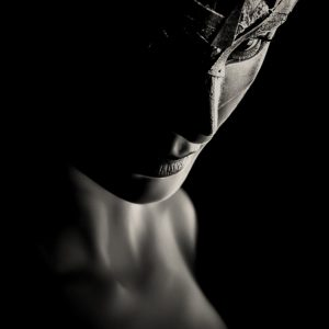 Low key portrait photography of a girl with Venetian mask