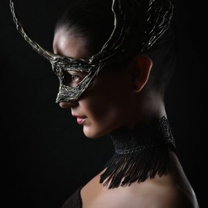 Portrait of girl with fashion dragon eye mask