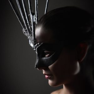 Portrait of young girl with conceptual carnival mask