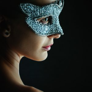 Woman wearing venetian masquerade mask