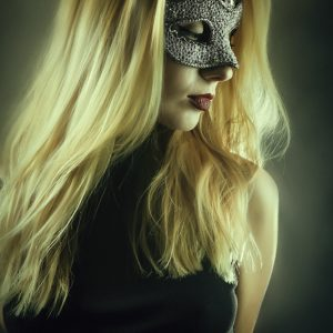 Girl with domino eye mask