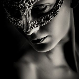 Mysterious woman with fantasy mask