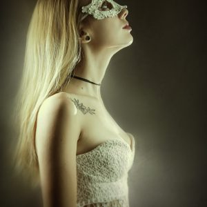 Portrait of girl with beautiful white lace mask