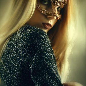 Portrait of woman with beautiful masquerade mask