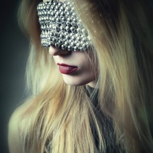 Woman with beautiful metal chrome plated mask