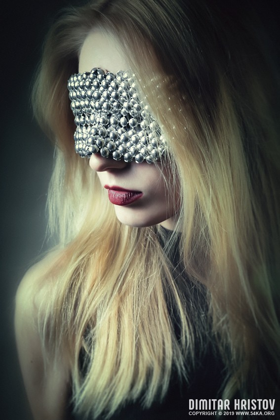 Woman with beautiful metal chrome plated mask photography venetian eye mask portraits featured fashion  Photo