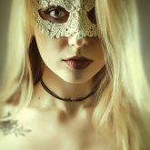 Woman with beautiful white lace mask