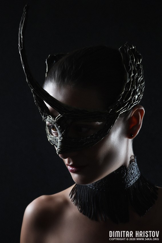 Low key strobist portrait of a girl with mask photography venetian eye mask portraits fashion  Photo