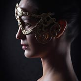 Portrait of attractive sensual young woman with mask