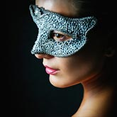 Remarkable portrait of a girl with silver Venice eye mask