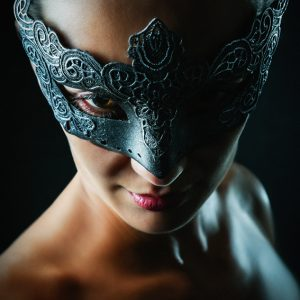 Strobist portrait of a girl with superhero mask