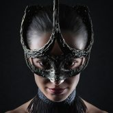 Strobist studio portrait of famous girl with face mask
