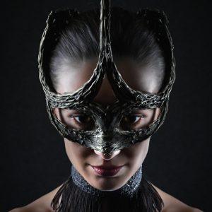 Strobist studio portrait of famous girl with face mask