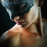 Studio portrait of a girl with beautiful dark mask