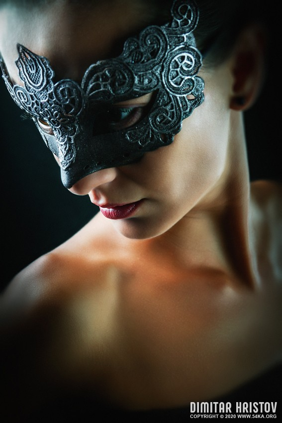 Studio portrait of a girl with beautiful dark mask photography venetian eye mask fashion  Photo