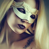 A gentle portrait of a girl with a white Venetian mask