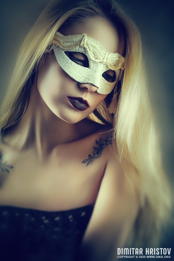 A gentle portrait of a girl with a white Venetian mask photography venetian eye mask featured fashion  Photo