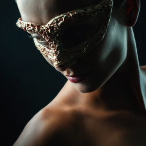 Beauty sensual portrait of a girl with mask