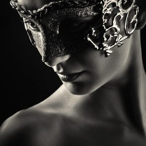 Girl with vintage venetian mask in black and white