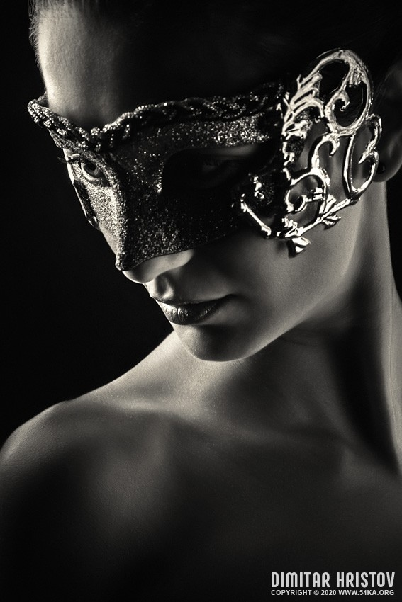 Girl with vintage venetian mask in black and white photography venetian eye mask fashion black and white  Photo