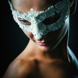 White lace eye mask – Portrait of young stylish woman
