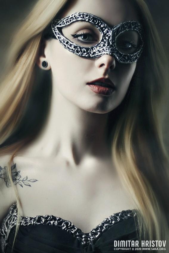 Vampire woman with venetian mask venetian eye mask daily dose  Photo