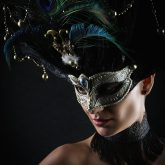 Girl with peacock feathers mask