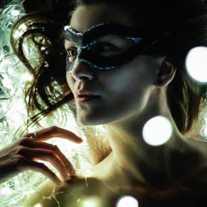 Expressive art portrait of a girl on lighting background