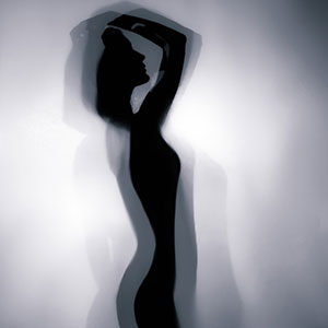 Silhouette of a girl in beautiful pose – Backlight photography