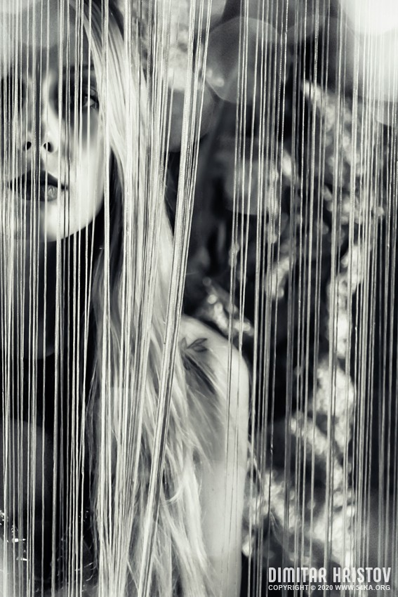 Beautiful sensual woman stands by the curtain photography portraits featured fashion black and white  Photo